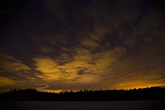 forest fire (sami kuosmanen) Tags: light sky lake snow ice yellow night forest suomi finland stars lumi mets y valo j taivas thdet keltainen