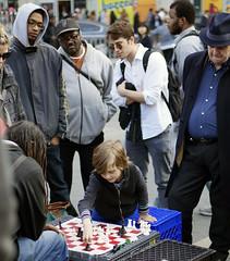 Prodigy (ashley.coventry) Tags: game 50mm kid child sony chess alpha spectators prodigy unionsquare winning nex6