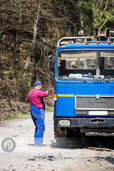 Is that a flat? (Cristian Sabau | Photography) Tags: road trip travel trees summer sunlight mountain man nature truck outdoors photography daylight spring day view flat human repair romania damage worker dirtroad transylvania caucasian mountainroad colorimage