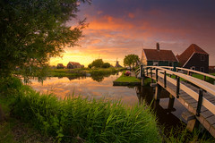 Green Lands (albert dros) Tags: travel bridge sunset summer green tourism netherlands dutch grass spring village windmills fisheye zaanseschans windmillvillage samyang albertdros