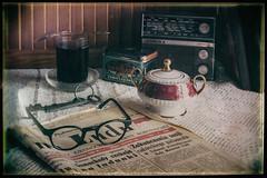 Cup of tea (Tomasz Aulich) Tags: trybunaludu communist newspaper communistnewspaper glasses tea boxoftea sugarbowl sugar radio glass table vintage oldschool stilllife books keys memory remember oldandgold poland nikon nikkor spoon indoor