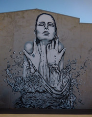 The Lady of the Lake (Steve Taylor (Photography)) Tags: ladyofthelake water splash splashing droplet hands deow deow1 art graffiti mural streetart blue brown grey woman lady newzealand nz southisland canterbury cbd city