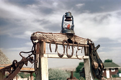 34-014 (ndpa / s. lundeen, archivist) Tags: nick dewolf nickdewolf color photographbynickdewolf 1970s 1973 film 35mm 34 reel34 weathered rust rusty equipment lamp lantern horseshoe horseshoes utah southwestutah southwesternunitedstates 1972