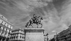 Carlos III (MarioPhotographyG) Tags: madrid historic puerta del sol bw blackandwhite sky clouds urban city urbex explorer exploring horse