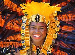 Carnival:  Leeds West Indian Carnival (Wilamoyo) Tags: westindianfestivalleeds2016 leeds female portrait color yellow feathers costume regalia smile caribbean beauty woman face feminine bright