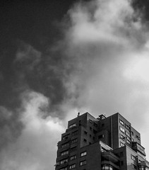 Sky Scraper (uberlisolivares) Tags: skies negativespace clouds city lomo chile sky bw building