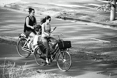 Inge Hoogendoorn (ingehoogendoorn) Tags: multitasking bike bikes dutchbikes dutchbike utrecht bicycle bicycles fiets fietsen venuslaan smartphone iphone phone cycling cycle multitask workinggirl blackandwhite blacknwhite zwartwit monochrome monochromatic monochroom