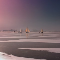 Nostalgic ice yachting relived anno 2013 (Bn) Tags: winter sun sunlight cold holland reflection ice netherlands topf50 glow iceskating skating thenetherlands wintertime topf100 marken speedskaters monnickendam frozensea markermeer historicalmoment naturalice 100faves 50faves coldwave gouwzee seaofice schaatsfeest schaatstocht ijs
