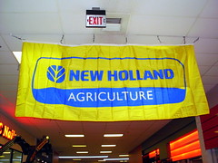 New Holland Agriculture Banner. (dccradio) Tags: wisconsin mall farming equipment machinery ag agriculture wi agricultural farmequipment farmshow marshfield farmmachinery centralwisconsin shoppesatwoodridge marshfieldmall wisconsinfarming machineryshow agshowagricultureshow