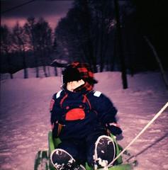 William and the pink snow (MarieMayhem) Tags: pink winter snow vinter sweden crossprocess william sledding sled sn sundsvall pulka vnddia didrikson