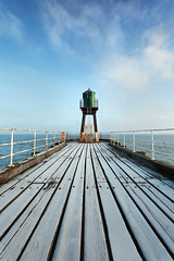 Chilled Pier (www.damientaylor.co.uk) Tags: life wood blue winter sea portrait sky people seascape cold west lines landscape dawn pier seaside frost skies walk no board yorkshire north grain freezing frosty ring freeze whitby boardwalk grains railings leading breezy
