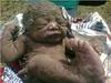 buried-baby2 (jfidexlover) Tags: same remain 9ja