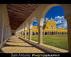 How do you say yellow in Spanish? (Sam Antonio Photography) Tags: old city travel shadow cloud history church latinamerica yellow horizontal architecture sanantonio catchycolors mexico outdoors photography ancient day arch sam religion yucatan nopeople courtyard monastery mayan northamerica christianity custom antonio convent renaissance pilgrimage colonnade traditionalculture yucatanpeninsula izamal padua placeofworship traveldestinations colorimage famousplace spanishculture locallandmark yellowcity architecturalfeature buildingexterior magictown stepsandstaircases yucatanstate conventodesanantoniodepadua builtstructure canoneos5dmarkii ciudadamarilla conventofsanantoniodepadua canon24105f4lens samantoniophotography gulfcoaststates mexicothecourtyardofthegreatmonasteryofizamal conventodesanantoniodepaduaconventofsanantoniodepadua theyellowcityofizamal whenthespanishconqueredizamaltheydestroyedthemayantemple populchacpyramidandin1533begantobuildfromitsstoneoneofthefirstmonasteriesinthehemispheretheworkwasfinishedin1561