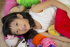 Kids Portrait (GI) (Alphone Tea) Tags: life light shadow portrait white black cute art beautiful smile childhood closeup kids composition contrast umbrella pose print children toys photography photo amazing bed model colorful asia pretty little sweet bokeh modeling sister room flash models chinese adorable indoor age malaysia sweets lovely staring softbox kuantan 1755 speedlite ste2 2013 60d 580exii