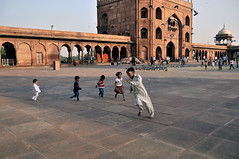 Round and Round (eternal_ag0ny) Tags: street new people india holiday playing happy photography kid nikon friend shot candid delhi small young human round nikkor masjid jama 18200mm d300s