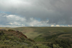 Nevada Hills and Rain 1 (Tatiana Gettelman) Tags: pictures sky mountain storm west nature grass rain clouds landscape outdoors photo big view natural image photos pics nevada country creative picture commons pic images sage hills photographs photograph mountian