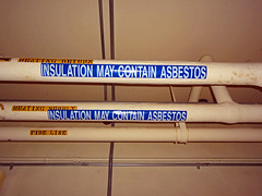 Insulation May Contain Asbestos (Asbestorama) Tags: warning label tag inspection pipe may insulation safety survey hazard epa asbestos osha thorough inspect communcation assumed regulated racm presumed pacm neshap