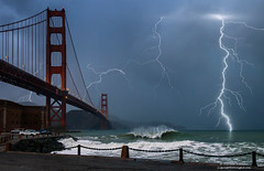 Lightning - Golden Gate Bridge (Darvin Atkeson) Tags: world ocean sanfrancisco california lighting bridge red sea orange storm art weather america wonder one bay design coast highway surf waves pacific suspension artistic fort steel painted united famous marin towers wave stormy international highway1 coastal civilwar goldengatebridge cables goldengate bolt bayarea headlands strike fortpoint artdeco states lightning thunder span darvin atkeson darv liquidmoonlightcom