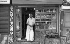 sandlewood (Bijou Lou) Tags: portrait bw india holiday art film shop 35mm pentax k1000 kerala ilford kochi 50iso shopowner fortcochin lc29 panfplus ilfotec
