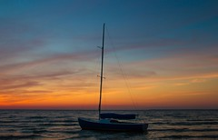 Sunset Sail (SueZinVT) Tags: brewsterflats sailboat capecodbay sunset color sky water waves sailing mast shadows silhouettes