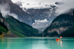 Canoe on Lake Louise (Erik Pronske) Tags: canadianrockies sunrise storm rockymountains nationalpark mountains glacier relection clouds banffnationalpark blue water trees alberta reflection mountvictoria canada still banff lakelouise canoe