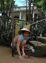 smiling lady (Claudio Triani) Tags: smile vietnam mekkong delta washing water lady