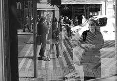 A Nun's Reflection (PM Kelly) Tags: nun reflection street photogrpahy story cork ireland religion bnw bw blackandwhite blackwhite blancoynegro window shop traffic pedestrian