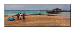 Causeway to the Beach Club (Fermat48) Tags: beachclub chiringuitolaisla caletadefauste fuerteventura canaryislands tents ocean sea water streetlamps sand bridge causeway atlantic beachumbrellas sandcastle walkway