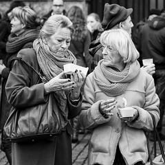 having a snack (Gerard Koopen) Tags: bw belgium belgie streetphotography antwerp antwerpen grotemarkt straatfotografie 2013 nieuwjaarsdrink havingasnack