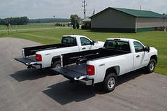 two white work trucks
