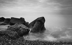 storm defences (Steve Denny) Tags: uk sea beach water stone clouds seaside waves sony pebbles hastings eastsussex englishchannel timedexposure a300 ndfilters sonydslr