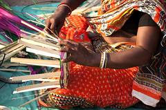 Bamboo basket making (Tapas Biswas) Tags: life morning travel people woman india color colour festival female work festive outdoors hands nikon women day basket image artistic market candid indian creative streetphotography craft streetlife fair indianmarket hindu bengal bengali artisticphotography westbengal candidphotography realpeople d90 basketmaking indianfestival indianculture nikond90 onlyindian indianfair nikod90 nikond9o basketscloseup