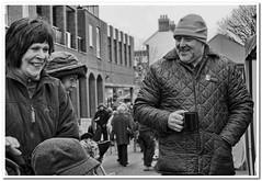 Happy days (Hugh Stanton) Tags: lighting street food cup monochrome photoshop photography town market tea action hats pedestrian groceries stubble topaz lightroom pensioner lumixg3 lumixg5