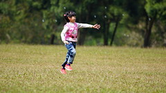 Family Happiness (a.lu.) Tags: family tree jump child daughter lawn meadow happiness laugh bubble grassplot