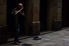 The Flutist, Barcelona, Spain (ShivRamky) Tags: barcelona life street old city travel people espaa music man color travelling colors work canon dark walking photography evening spain alley europa europe flickr mood play pov walk poor culture lifestyle flute age larambla lonely hardwork handwork catalana 500d shivramky uploaded:by=flickrmobile flickriosapp:filter=nofilter