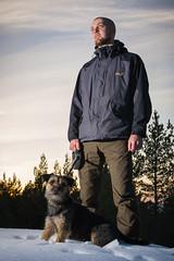 Sunset strobing (Ilkka Hakamki) Tags: lighting trees winter sunset portrait dog snow man guy animal silhouette 35mm finland nikon turku border terrier nikkor 18 strobe dx nauvo strobist d3100