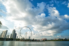 Singapore Flyers 02 (yewkwangphoto) Tags: sea cloud seascape tourism water horizontal architecture landscape singapore asia cityscape bluesky tourist tropical skyscaper commercialbuilding ferrywheel placeofinterest buildingstructure photocategory singaporeflyers yewkwang photographybyyewkwang