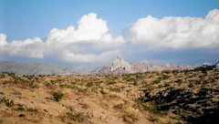 Nevada In View (Shot by Newman) Tags: nevada nature desert plantlife clouds shotbynewman fujifilm fuji400 daylight 35mm rockformations view