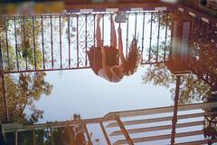 (Nowhere land) Tags: girl chica mujer woman cayendo falling water agua reflejo reflection cada fall sky cielo reja bars hair longhair cabello pelo cabellolargo