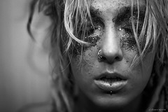 IMG_1230 (Brett Kotch!) Tags: portrait monochrome blackwhite blackandwhite bw noiretblanc model chick girl woman lady face detail glitter blonde modelling piercing dreadlocks closeup bokeh 50mm canon photography traveler bkp indoors people indoor grey