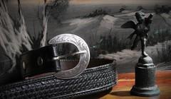 Diablo (Rand Luv'n Life) Tags: odc our daily challenge belt buckle diablo engraved silver black leather bronze angel dark pastel landscape good bad ugly indoor composition
