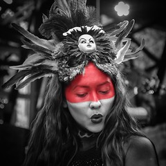 Red (tim.perdue) Tags: red color monochrome bw black white independents day festival 2016 columbus ohio franklinton girl woman person portrait candid street face paint makeup headdress feathers dancer hula hooper entertainer performer