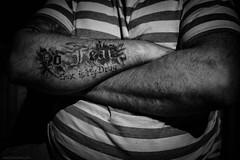 impassive (jrockar) Tags: portraitbw mono blackandwhite tattoo man x100s fuji rangefinder komarno slovakia streetphotography documentary moment instant snap shot nofear sex drug statement impassive jrockar janrockar idiot ordinarymadness