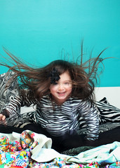 (stOOpidgErL) Tags: motion girl hair toddler zebra jumpingonthebed chloepearl