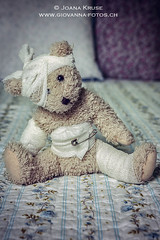give me some comfort (Ticino-Joana) Tags: bear cute toy bed bedroom pin sad teddy wounded compassion dressing teddybear stuffedanimal blanket conceptual plaid comfort unhappy bandage duvet wounds injured bandages pity safetypin plushtoy dressings cuddletoy fixingpin