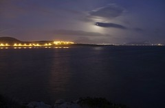 Full moon rising, obscured by clouds (n.pantazis) Tags: longexposure winter sea sky moon night clouds reflections lights nightshot streetlamps trail obscured obscure saronicgulf vouliagmeni saronikos pentaxk30 pwpartlycloudy