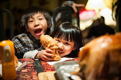 Dinner Table Mischief (Justin Lo Photography) Tags: life christmas family boy people food girl childhood kids dinner turkey children bread happy holidays child sister brother candid warmth happiness siblings