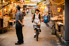 Girl on Bike (candersonclick) Tags: china vacation hongkong asia honeymoon lily streetphotography kowloon fishingvillage 2012 lantauisland lantau taio nikond600 tankavillage