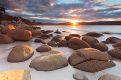 Bay Of Fires (stevoarnold) Tags: ocean blue sunset sky seascape water clouds sunrise rocks day cloudy australia boulders tasmania tassie starburst bayoffires