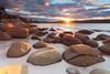 Bay Of Fires (stevoarnold) Tags: ocean blue sunset sky seascape water clouds sunrise rocks day cloudy australia boulders tasmania tassie starburst bayoffires